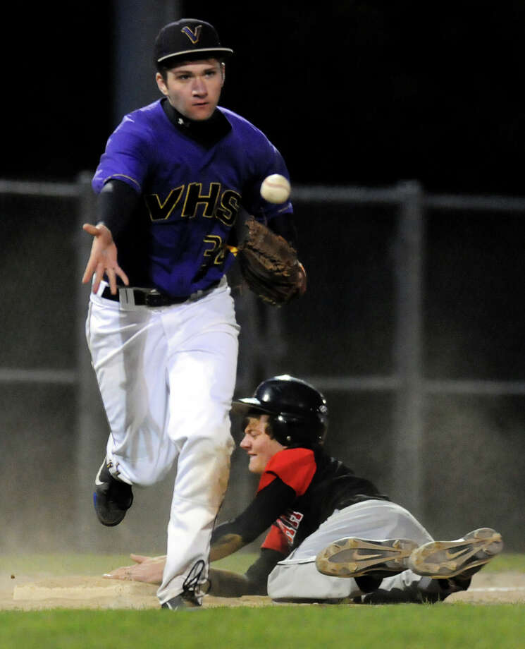 Voorheesville's third baseman Mike Young (34), left, tags out Chatham's Mike Verschelden (21) during their baseball game on Thursday, April 12, 2012, at  Roger Keenholts Park in Guilderland, N.Y. (Cindy Schultz / Times Union) Photo: Cindy Schultz / 00017218A