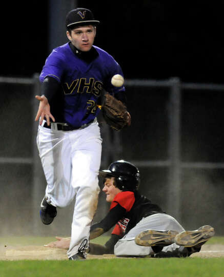 Voorheesville's third baseman Mike Young (34), left, tags out Chatham's Mike Verschelden (21) during