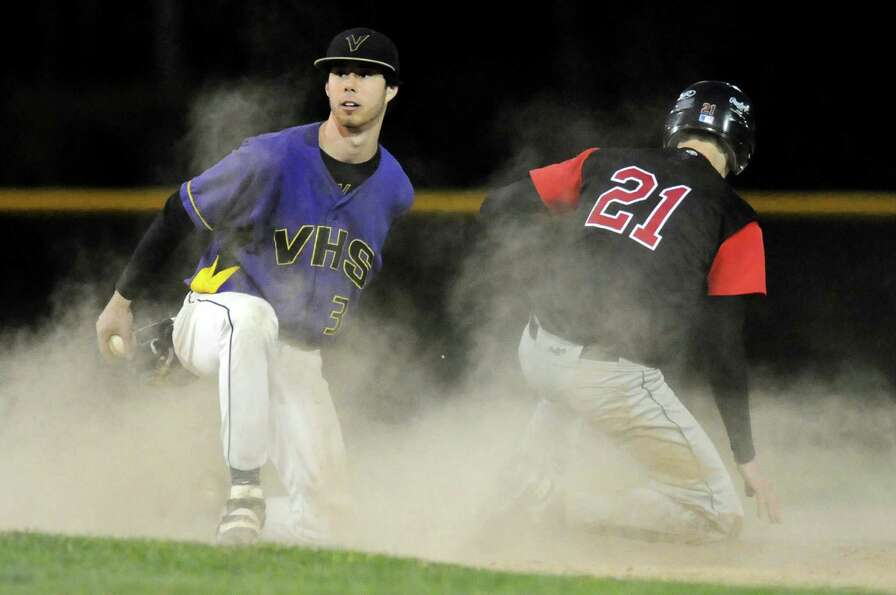 Voorheesville's shortstop Nico Church (3), left, misses the tag when Chatham's Mike Verschelden (21)