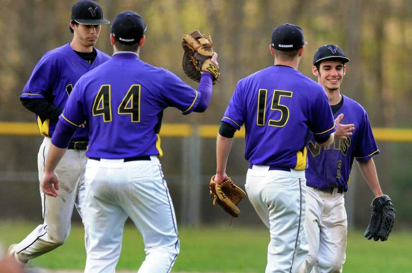 Voorheesville infielders celebrate the third out of the inning during their baseball game against Ch