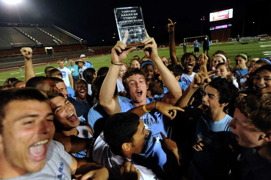 Members of the Johnson High School boys track team celebrate after winning the team title during the finals of the District 26-5A track championships at Heroes Stadium on Thursday, April 12,  2012. Billy Calzada / San Antonio Express-News Photo: BILLY CALZADA, Express-News / SAN ANTONIO EXPRESS-NEWS