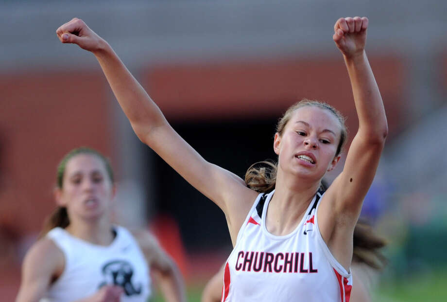 Sarah Fritzsche of Churchill celebrates after finishing the girls 3200-meter run during the finals of the District 26-5A track championships at Heroes Stadium on Thursday, April 12,  2012. The race was won by Natalie Langan of Johnson. Billy Calzada / San Antonio Express-News Photo: BILLY CALZADA, Express-News / SAN ANTONIO EXPRESS-NEWS
