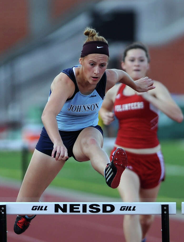 Kassie Frietag of Johnson wins the girls 300-meter hurdles during the finals of the District 26-5A track championships at Heroes Stadium on Thursday, April 12,  2012. Billy Calzada / San Antonio Express-News Photo: BILLY CALZADA, Express-News / SAN ANTONIO EXPRESS-NEWS