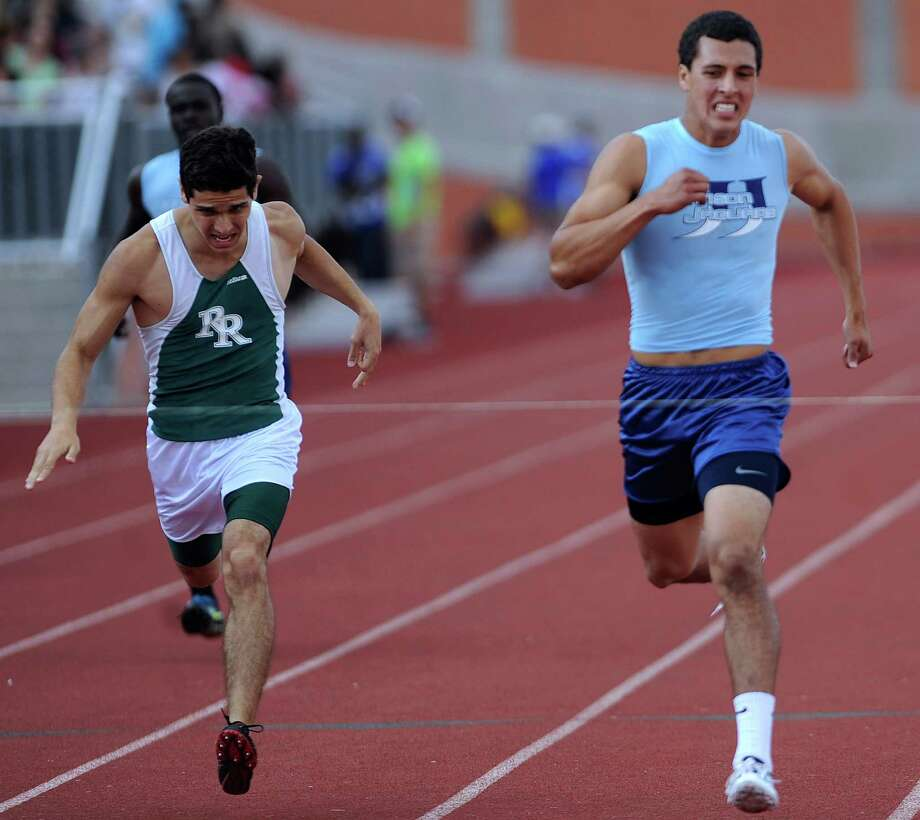 Andres Salazar of Johnson, right, edges out Jose Arroyo of Reagan in the boys 400-meter dash during the finals of the District 26-5A track championships at Heroes Stadium on Thursday, April 12,  2012. Billy Calzada / San Antonio Express-News Photo: BILLY CALZADA, Express-News / SAN ANTONIO EXPRESS-NEWS