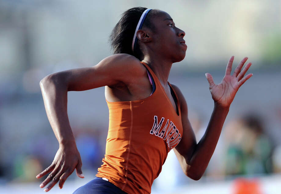 Ciara Dickerson of Madison runs enroute to victory in the girls 400-meter dash during the finals of the District 26-5A track championships at Heroes Stadium on Thursday, April 12,  2012. Billy Calzada / San Antonio Express-News Photo: BILLY CALZADA, Express-News / SAN ANTONIO EXPRESS-NEWS