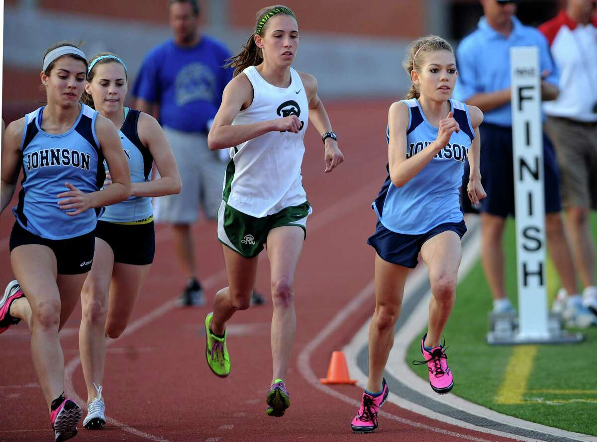 Natalie Langan of Johnson High School, right, and competitors are off at the start of the girls 3200 meter run during the finals of the District 26-5A track championships at Heroes Stadium on Thursday, April 12, 2012. Langan won the race. Billy Calzada / San Antonio Express-News