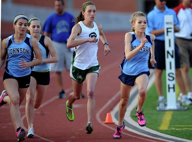 Natalie Langan of Johnson High School, right, and competitors are off at the start of the girls 3200 meter run during the finals of the District 26-5A track championships at Heroes Stadium on Thursday, April 12,  2012. Langan won the race. Billy Calzada / San Antonio Express-News Photo: BILLY CALZADA, Express-News / SAN ANTONIO EXPRESS-NEWS