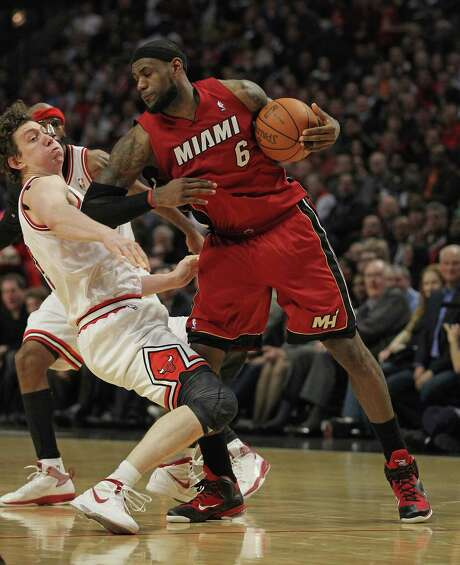 LeBron James, getting pushy with Omer Asik, had the most impressive individual performance with 30 points, but the Bulls prevailed with team play. Photo: Jonathan Daniel / 2012 Getty Images