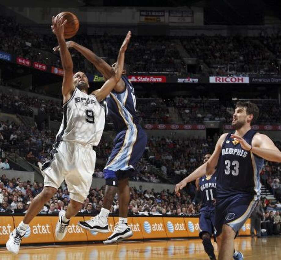 The Spurs' Tony Parker drives to the basket under Memphis Grizzlies' Gilbert Arenas as Memphis Grizzlies' Marc Gasol looks on  during first half action Thursday April, 12,  2012 at the AT&T Center. (PHOTO BY EDWARD A. ORNELAS/SAN ANTONIO EXPRESS-NEWS) (EDWARD A. ORNELAS / SAN ANTONIO EXPRESS-NEWS)