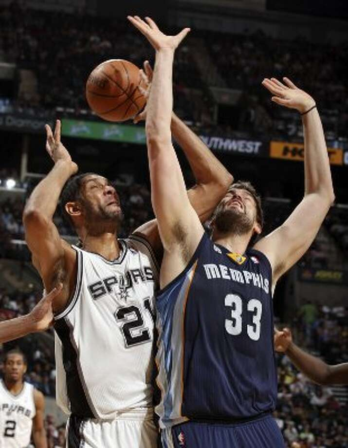 The Spurs' Tim Duncan and Memphis Grizzlies' Marc Gasol grab for a rebound during first half action Thursday April 12,  2012 at the AT&T Center. (PHOTO BY EDWARD A. ORNELAS/SAN ANTONIO EXPRESS-NEWS) (EDWARD A. ORNELAS / SAN ANTONIO EXPRESS-NEWS)