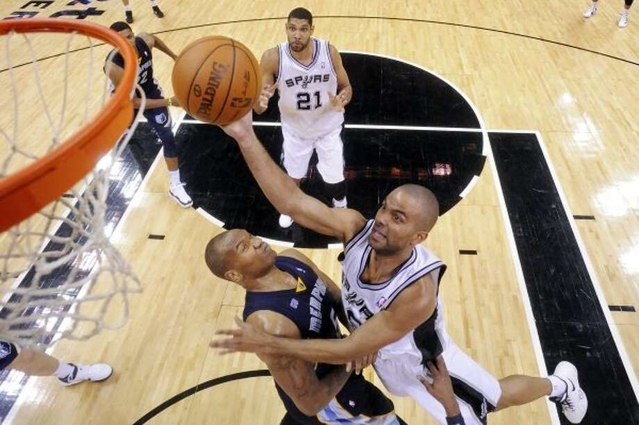 The Spurs' Tony Parker shoots over Memphis Grizzlies' Marreese Speights during second half action Thursday April 12,  2012 at the AT&T Center. The Spurs won 107-97.  (PHOTO BY EDWARD A. ORNELAS/SAN ANTONIO EXPRESS-NEWS) (EDWARD A. ORNELAS / SAN ANTONIO EXPRESS-NEWS)