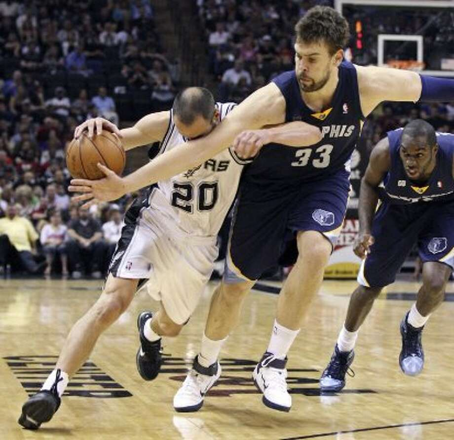 The Spurs' Manu Ginobili is fouled by  Memphis Grizzlies' Marc Gasol as Memphis Grizzlies' Quincy Pondexter looks on  during second half action Thursday April 12,  2012 at the AT&T Center. The Spurs won 107-97.  (PHOTO BY EDWARD A. ORNELAS/SAN ANTONIO EXPRESS-NEWS) (EDWARD A. ORNELAS / SAN ANTONIO EXPRESS-NEWS)