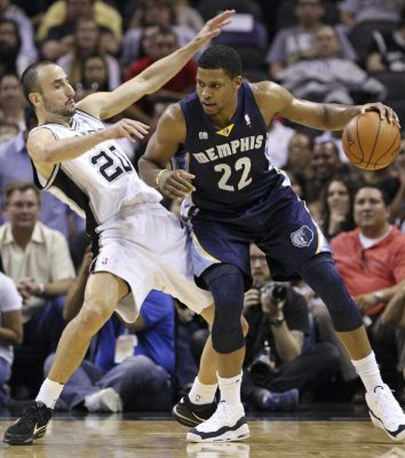 The Spurs' Manu Ginobili defends Memphis Grizzlies' Rudy Gay during first half action Thursday April, 12,  2012 at the AT&T Center. (PHOTO BY EDWARD A. ORNELAS/SAN ANTONIO EXPRESS-NEWS) (EDWARD A. ORNELAS / SAN ANTONIO EXPRESS-NEWS)
