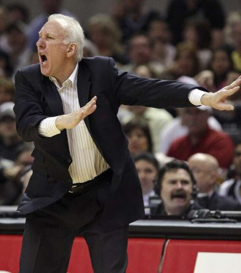 Spurs coach Gregg Popovich yells instructions to the team against the Memphis Grizzlies during second half action Thursday April 12,  2012 at the AT&T Center. The Spurs won 107-97.  (PHOTO BY EDWARD A. ORNELAS/SAN ANTONIO EXPRESS-NEWS) (EDWARD A. ORNELAS / SAN ANTONIO EXPRESS-NEWS)
