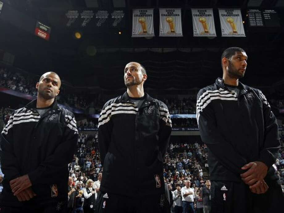 The Spurs' Tony Parker (from left), Manu Ginobili, and Tim Duncan stand during the national anthem before the game with the Memphis Grizzlies Thursday April 12,  2012 at the AT&T Center. (PHOTO BY EDWARD A. ORNELAS/SAN ANTONIO EXPRESS-NEWS) (EDWARD A. ORNELAS / SAN ANTONIO EXPRESS-NEWS)