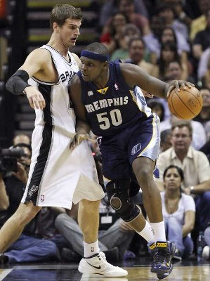 The Spurs' Tiago Splitter defends Memphis Grizzlies' Zach Randolph during first half action Thursday April 12,  2012 at the AT&T Center. (PHOTO BY EDWARD A. ORNELAS/SAN ANTONIO EXPRESS-NEWS) (EDWARD A. ORNELAS / SAN ANTONIO EXPRESS-NEWS)