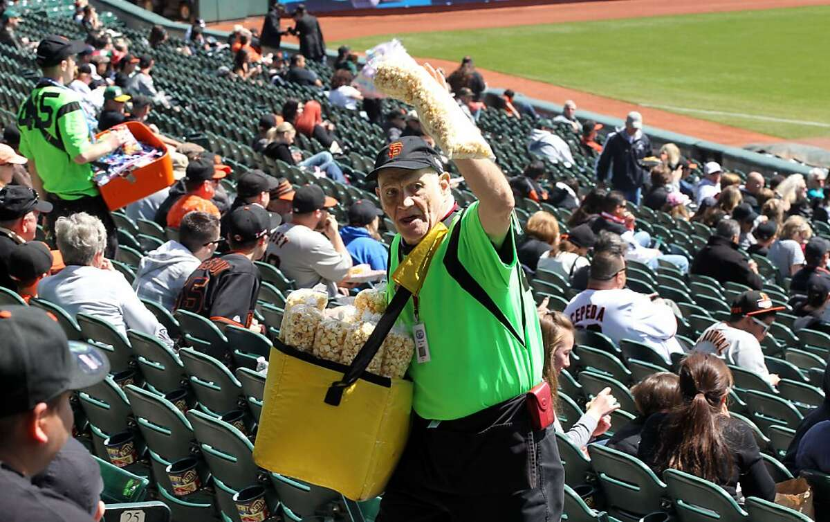 The Kettle Corn Man, who goes by the name Crazy Legs, sells Kettle Corn to Giants fans at AT&T Park. Wednesday, April 4, 2012. Crazy Legs is best known for his dances between innings while the music is playing.