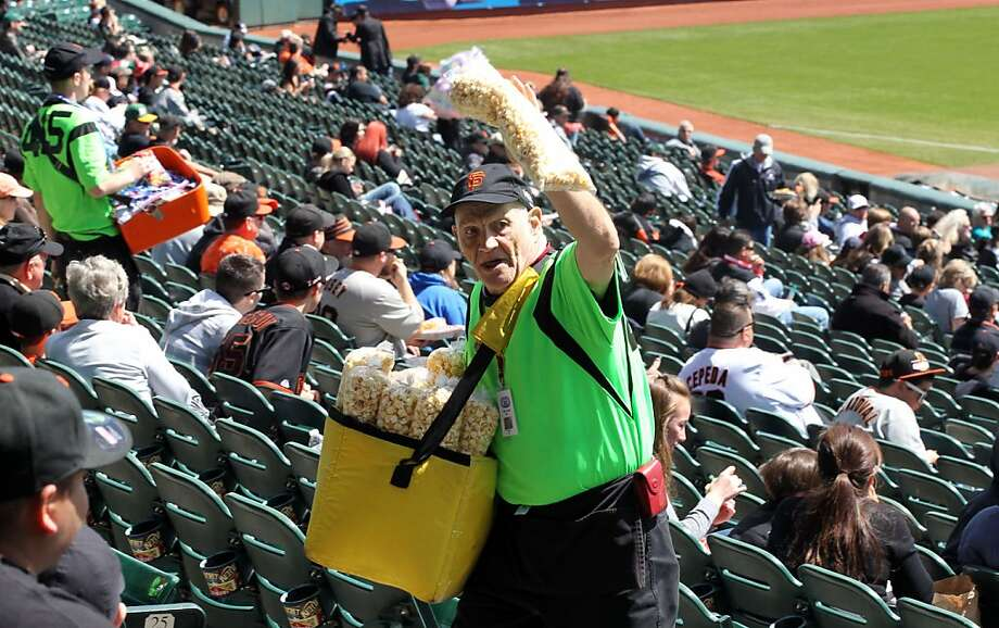Dancing vendor Howard Ellsworth Lowe sells kettle corn to Giants fans at AT&T Park. Photo: Lance Iversen, The Chronicle