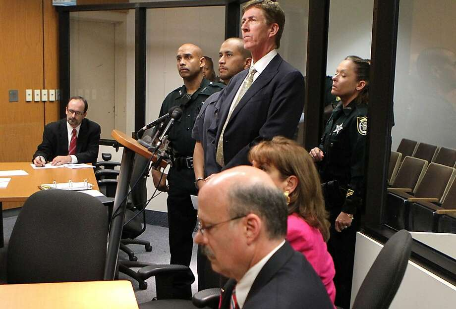 George Zimmerman (C) appears for a bond hearing with his attorney Mark O'Mara at the John E. Polk Correctional Facility April 12, 2012 in Sanford, Florida. Zimmerman was charged yesterday with second degree murder in the fatal shooting of 17-year-old Trayvon Martin who died February 26, 2012.  (Photo by Gary Green/The Orlando Sentinel-Pool/Getty Images) Photo: Pool, Getty Images