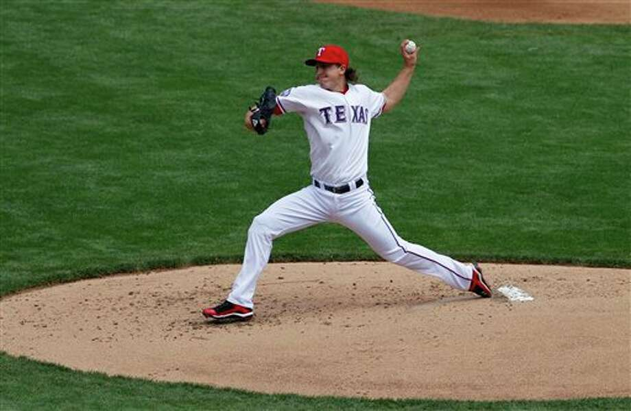 Texas starter Derek Holland struck out eight with no walks to get a win Thursday. Photo: Associated Press