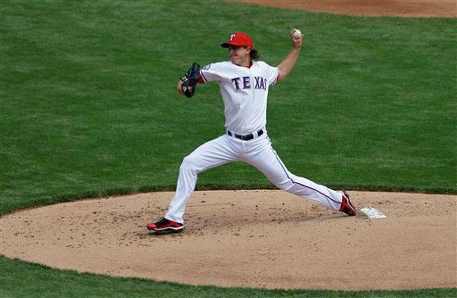 Texas starter Derek Holland struck out eight with no walks to get a win Thursday. Photo: Associated Press