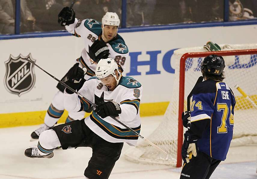 The San Jose Sharks' Martin Havlat (9) scores in the first period against the St. Louis Blues and T.
