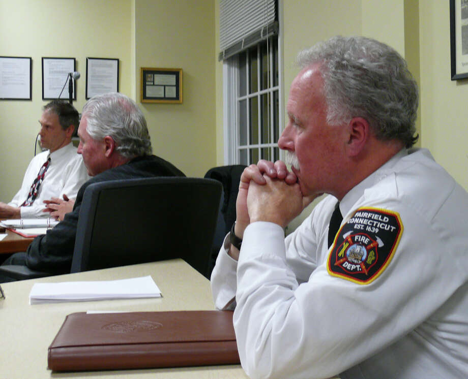 Deputy Fire Chief Art listens Thursday night as the Fire Commission discusses extending his contract, which was set to expire in December. The board approved a two-year extension on a 5-2 vote. Photo: Genevieve Reilly / Fairfield Citizen