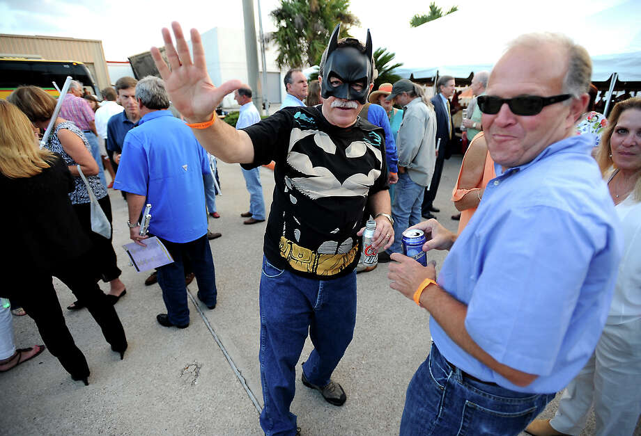 Darrell Jacob parties as batman with hundreds of visitors during the 2012 Julie Rogers Gift of Life's Champagne and Ribs fundraiser at Cowboy Harley Davidson in Beaumont, Thursday, April 12, 2012. The annual charity event raises money for prostate cancer screenings. Tammy McKinley/The Enterprise Photo: TAMMY MCKINLEY