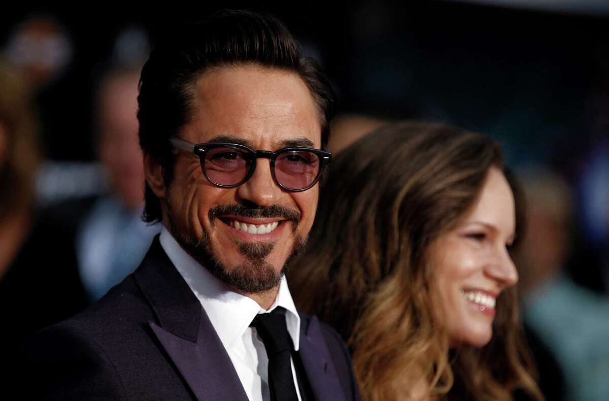 Cast member Robert Downey Jr., left, and Susan Downey arrive at the premiere of