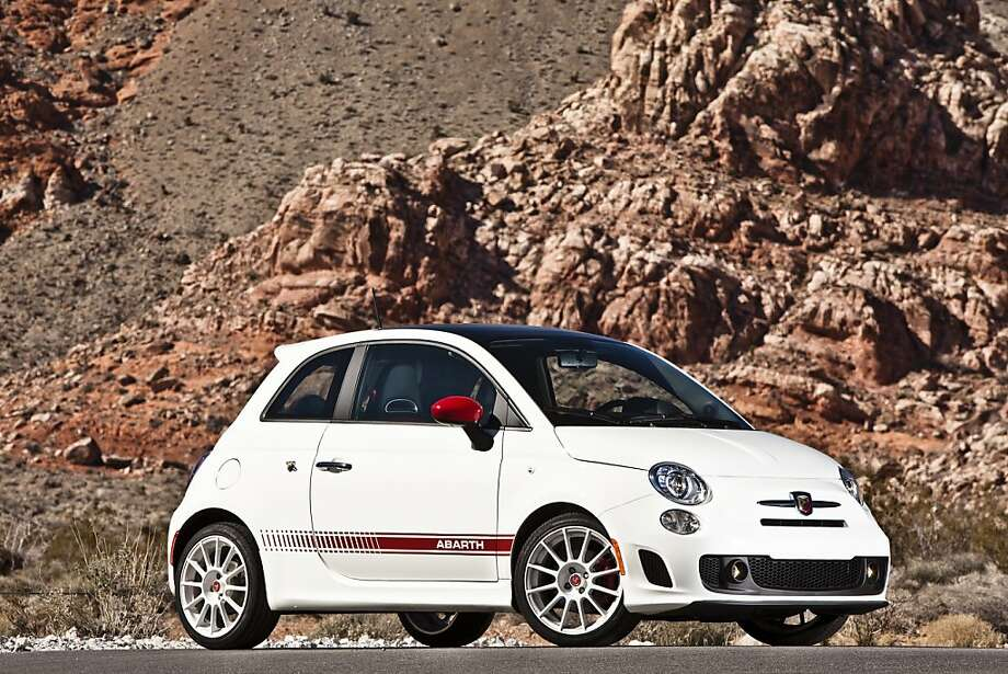 "In terms of the Abarth's differentiation from other available 2012 Fiat 500 models, the front facia is noticeably more pronounced, extending 2.7 inches ahead of its signature ""whiskers and logo"" face Photo: Chrysler Group, New York Times"