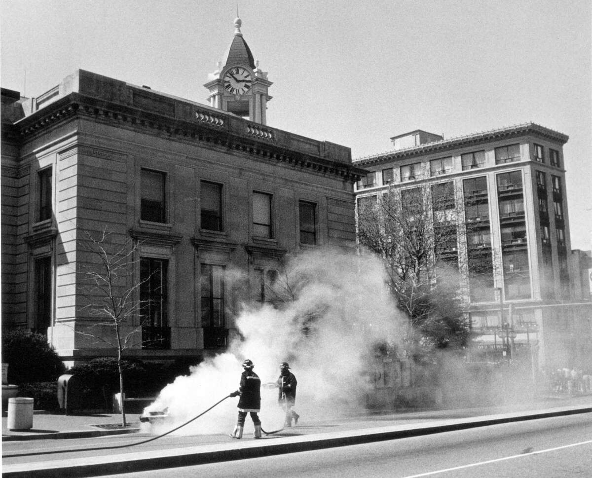 April 21, 1987: Firemen douse a car blaze near Stamford's Old Town Hall yesterday.