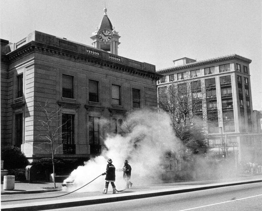 April 21, 1987: Firemen douse a car blaze near Stamford's Old Town Hall yesterday. Photo: File Photo