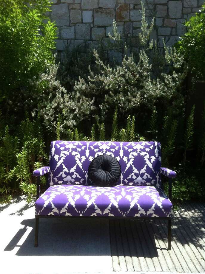 A graphic pattern on fresh upholstery wakes up a vintage settee. Bold patterns make traditional pieces fresh and young.