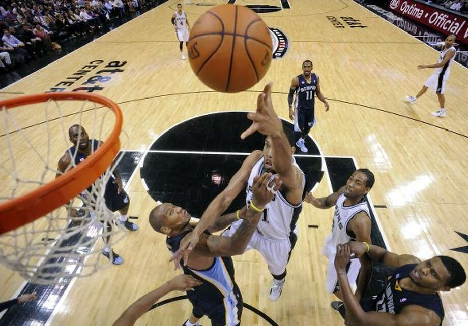 FOR SPORTS - San Antonio Spurs'  Tim Duncan shoots around Memphis Grizzlies' Marreese Speights during second half action Thursday April 12,  2012 at the AT&T Center. The Spurs won 107-97.  (PHOTO BY EDWARD A. ORNELAS/SAN ANTONIO EXPRESS-NEWS) (SAN ANTONIO EXPRESS-NEWS)