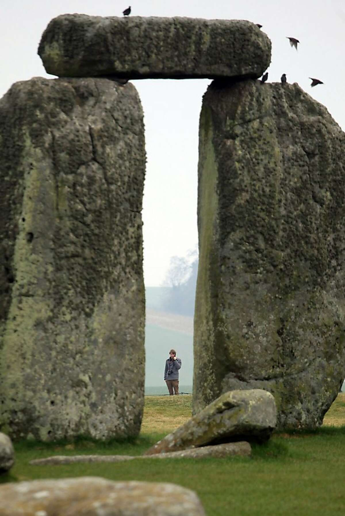 Visitors and tourists walk around the ancient monument at Stonehenge on March 2 2012 in Wiltshire, England. (Photo by Matt Cardy/Getty Images)