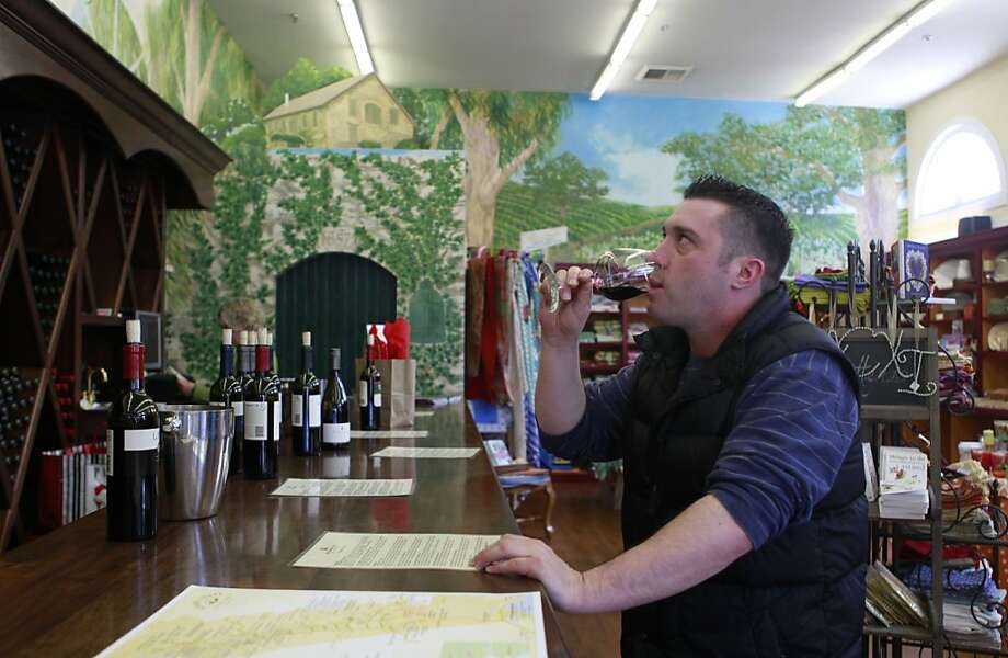 Jason Holden, who lives in Sonoma samples some wine from the Highway 12 tasting room, which is located in a shop selling knick-knacks, clothes and boutique goodies. In Sonoma, Calif. on Thursday, April 5, 2012. Photo: Jill Schneider, The Chronicle
