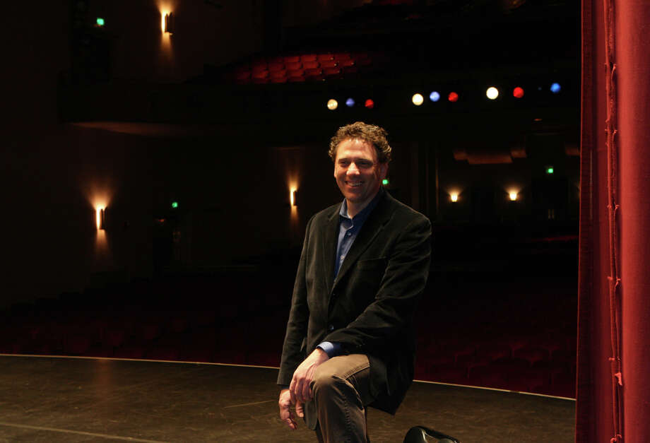 Karl Gasteyer stands on the stage of  the Klein Memorial Auditorium in Bridgeport, Conn. on Monday, April 2, 2012. Gasteyer, a teacher, producer, actor, and choreographer, is the new director of the Klein. Photo: B.K. Angeletti / Connecticut Post