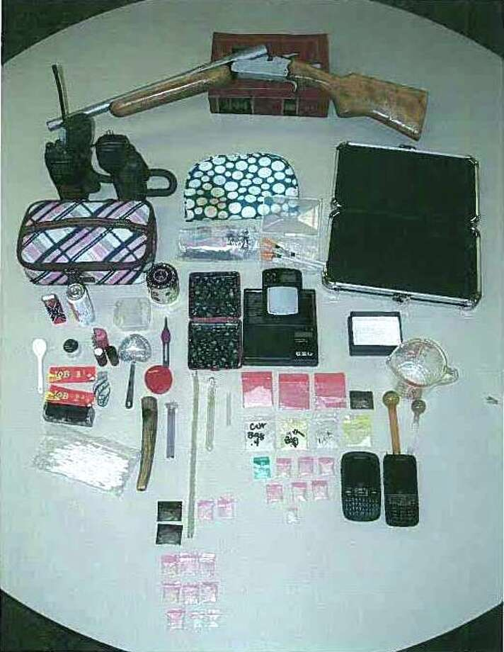 A cache of drugs, weapons, and paraphernelia was seized by Hardin County Sheriff's Office on Tuesday, April 10. Two people were arrested and two children were removed from the home where the items were found. Photo: Hardin County Sheriff's Office, HCN_Droddy Arrest