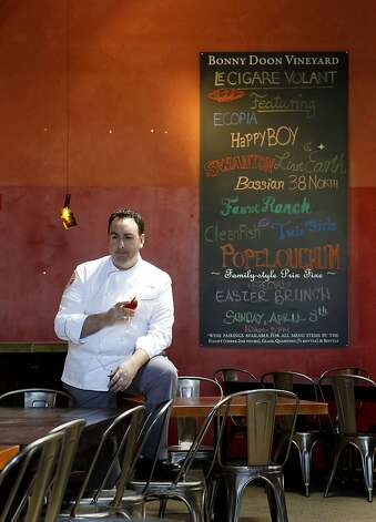 New chef Ryan Shelton pauses in the dining room of his restaurant shortly before opening for the evening. Le Cigare Volant, formerly Cellar Door, near downtown Santa Cruz, shares a space with the Bonny Doon Vineyard tasting room. Photo: Brant Ward, The Chronicle