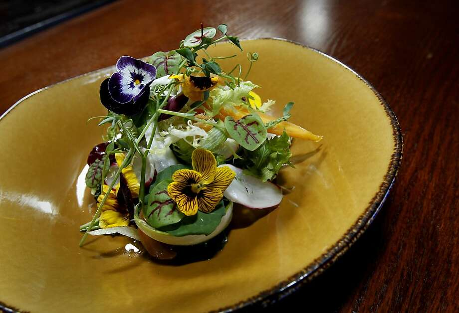 A Faurot Ranch Fennel Salad being served at Le Cigare Volant. Le Cigare Volant, formerly Cellar Door, near downtown Santa Cruz, shares a space with the Bonny Doon Vineyard tasting room. Photo: Brant Ward, The Chronicle