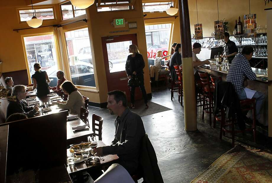 The dining room of La Posta, where live music plays on weeknights. Restaurants in the Santa Cruz area selected include Le Cigare Volant, La Posta, Soif, Au Midi and Gayle's Bakery. Photo: Brant Ward, The Chronicle