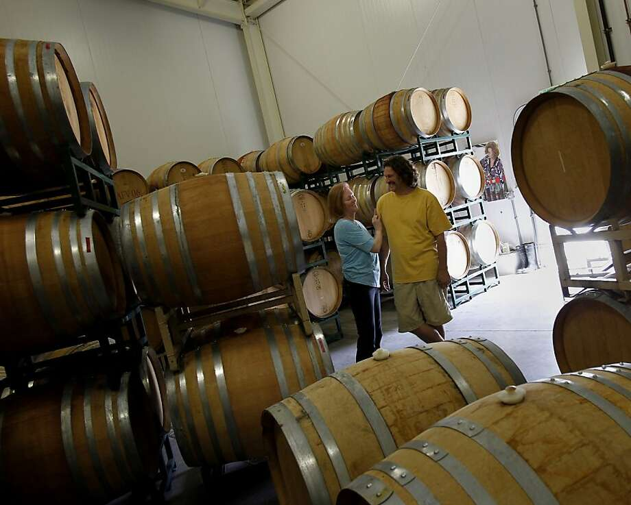The Alfaro family uses French oak barrels in their winemaking process. Two vineyards in Corralitos, Calif. are producing wonderful wines including Chardonnay and Pinot Noir.  Richard and Mary Kay Alfaro and their Alfaro Family winery and Peter and Barbara Woodruff. Photo: Brant Ward, The Chronicle