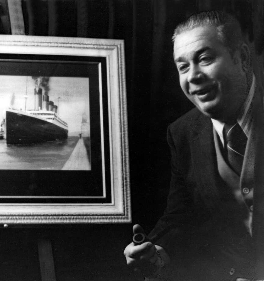 William Tantum IV, a Riverside, Conn., resident known as Mr. Titanic for his role in spreading the story of the RMS Titanic, is pictured in an undated photograph beside a framed picture of the doomed ship. The ship struck an iceberg and sank on April 15, 1912. Tantum died at the age of 49 in 1980, five years before his friend, oceanographer Robert Ballard, led the team that discovered the ship. Photo courtesy of the Titanic Historic Society. Photo: Contributed Photo / CT