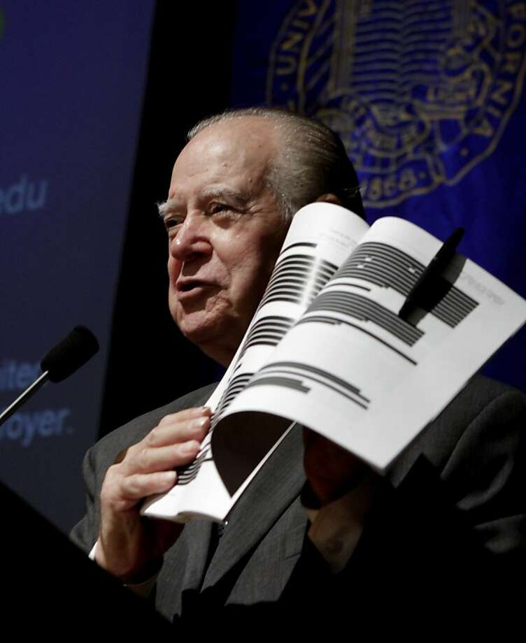 Retired California Supreme Court Justice Cruz Reynoso, who led a 13 member task force looking into the pepper spraying incident that occurred at the University of California, Davis last November, holds up a early copy of the report during a town hall style meeting held at the campus in Davis, Calif., Wednesday,  April 11, 2012.  The report  was originally set for release March 6, but lawyers for the law enforcement officers involved wanted more than 60 percent of the document blacked out claiming it contained personnel records that should not be publicly released under state law.  The final report was released with much of the information reinstated but without the names of most of the officers involved in the clash. (AP Photo/Rich Pedroncelli) Photo: Rich Pedroncelli, Associated Press