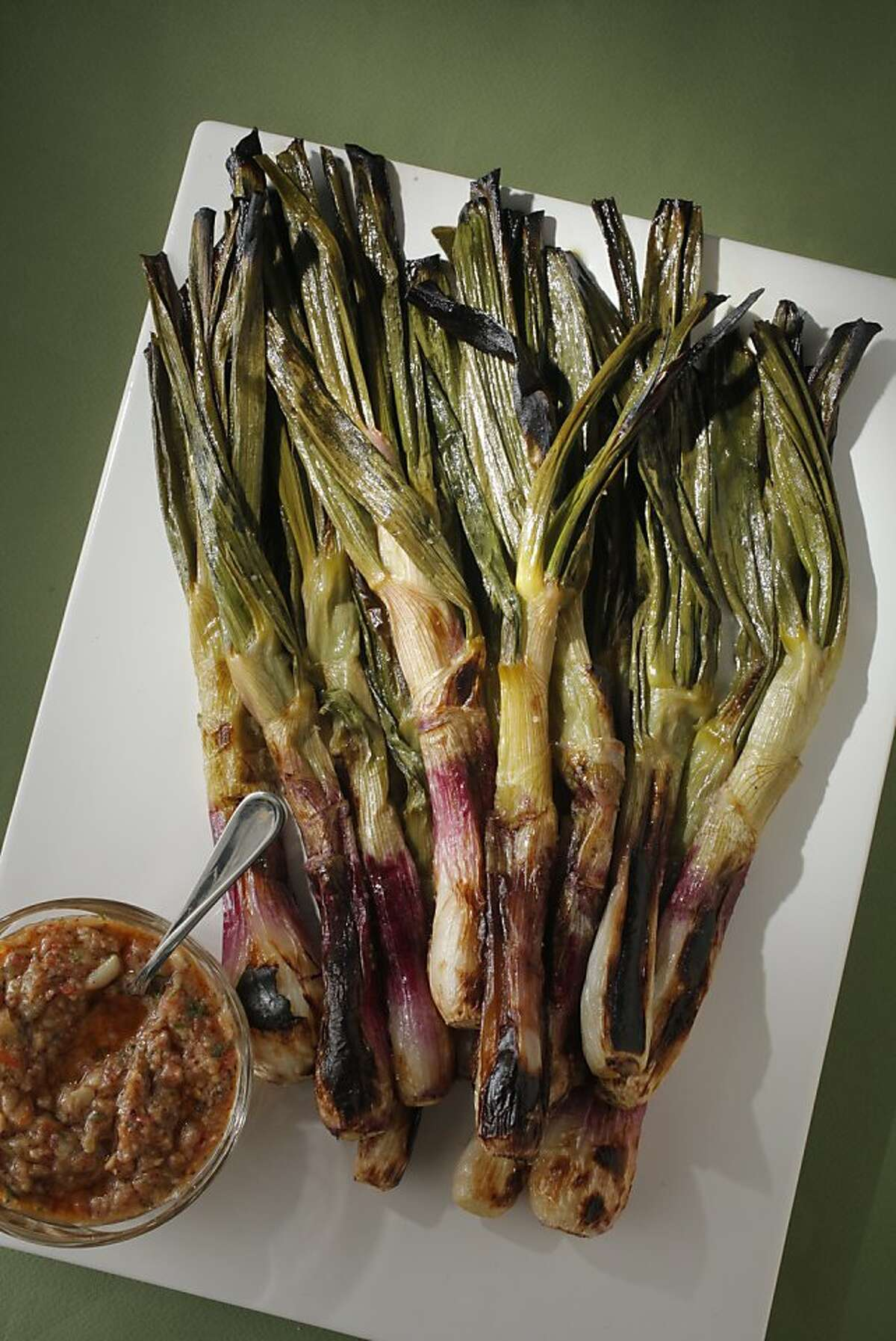 Little Grilled Calçot Onions with Salvitjada as seen in San Francisco on April 11, 2012. Food styled by Stephanie Kirkland.