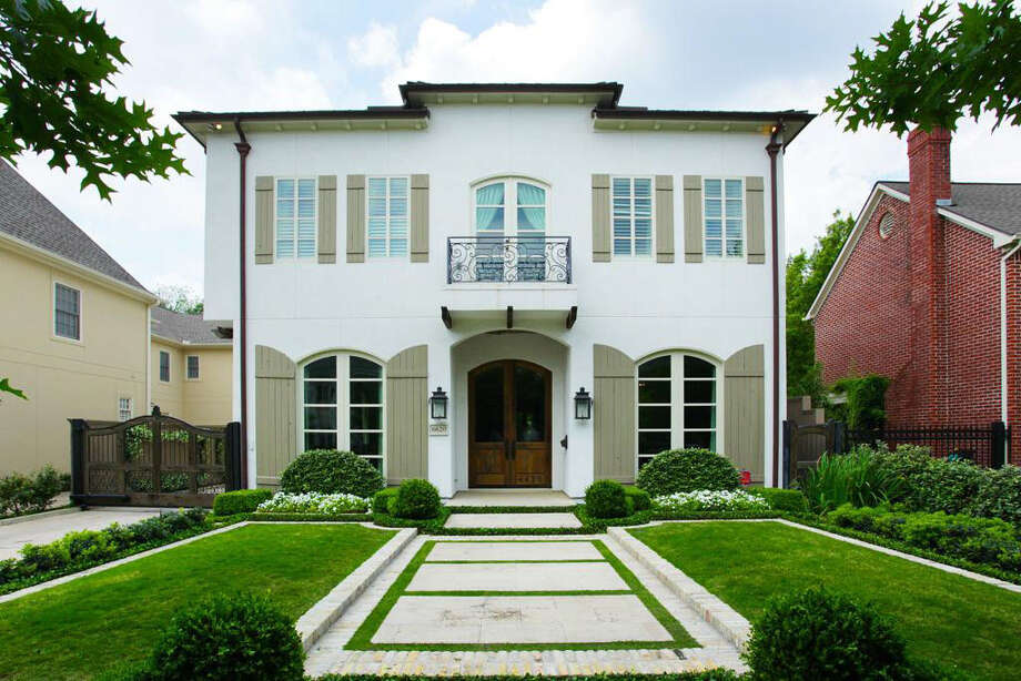 An external view of the front of the home, spotlighting the yard's symmetrical landscaping. Photo: Realtor.com