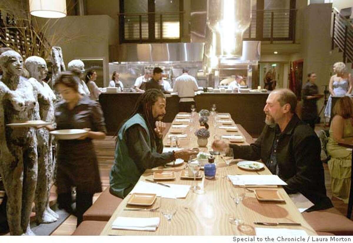d.21UBANTU_0036_LKM.jpg Dre Jonson (left) and Jeff Dawson eat dinner at the communal table at Ubuntu, a vegetarian restaurant in Napa. (Laura Morton/Special to the Chronicle) *** Dre Jonson *** Jeff Dawson