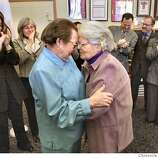 A69C0585.JPG  Phyllis Lyon, left, and Del Martin, who have been together for 51 years, embrace after their marriage at city Hall. They are the first legally married same-sex couple in San Francisco. In the background from left are Kate Kendell, Executive director of the National Center for Lesbian Rights, and Roberta Achtenberg, Senior Vice President of the San Francisco chamber of Commerce. In the background on the right are members of Mayor Gavin Newsom's staff, including Steve Kawa, center, chief of Staff and Joyce Newstat, Director of Policy, far right..  The first legally married same-sex couple in San Francisco are married by City assessor/Recorder mabel Teng in her office at City Hall. Phyllis Lyon and Del Martin, who have been together for 51 years say their vows.  LIZ MANGELSDORF/ The Chronicle  MAGS OUT/TV OUT/NO SALES Phyllis Lyon (left) and Del Martin, who have been together for 51 years, embrace after their historic marriage ceremony at City Hall. Phyllis Lyon (left) and Del Martin, lesbian activists who have been together for 51 years, embrace after their marriage ceremony at San Francisco City Hall. Ran on: 06-20-2004  Dinh Ngoc Tran, 88, left, and his wife, Nhan Thi Tran, 84, have been together since 1932. Ran on: 08-13-2004  Phyllis Lyon (left) and Del Martin, together for 51 years, were the first of 90 same-sex couples to be married at City Hall on Feb. 12.  ALSO RAN 12/26/04 Ran on: 02-12-2005 Ran on: 02-12-2005 MANDATORY CREDIT FOR PHOTOG AND SF CHRONICLE/NO SALES-MAGS OUT