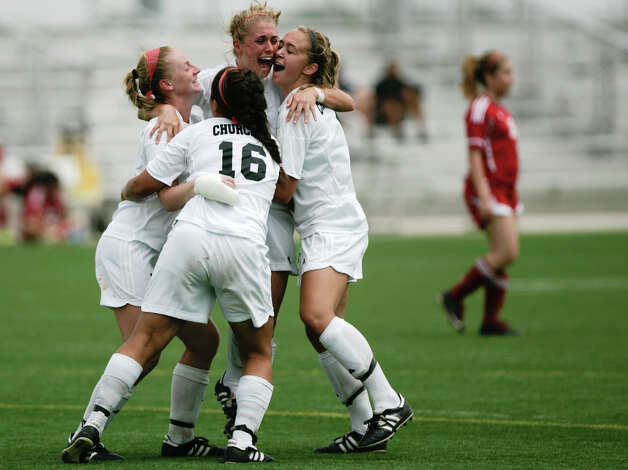 The Churchill girls celebrate their goal on Friday afternoon's UIL Region IV-5A Soccer Tournament game against the Harlingen Cardinals at the Brownsville Sports Park.    Photo By Yvette Vela/ The Brownsville Herald Photo: Yvette Vela / Yvette Vela
