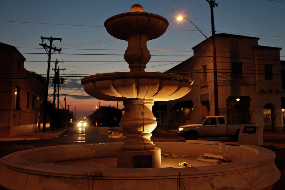 A fountain in the center of the roundabout at East Olmos Drive and McCullough Avenue, which has been hit by suspected drunken drivers several times, is lit at dusk in Olmos Park on April 10, 2012. Photo: Lisa Krantz, SAN ANTONIO EXPRESS-NEWS / SAN ANTONIO EXPRESS-NEWS